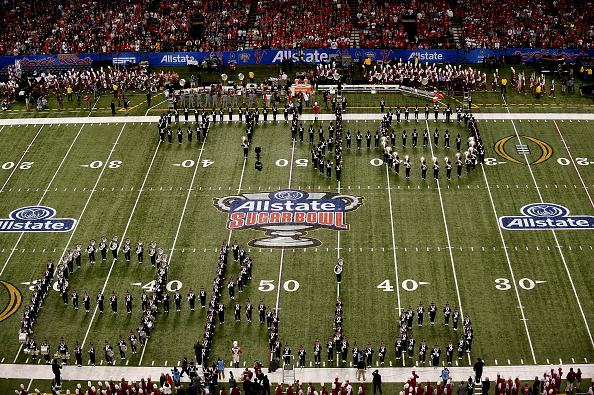 """Ohio fans singing """"Hang on Sloopy"""" together with the marching band during a football game"""