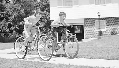 two kids riding bikes